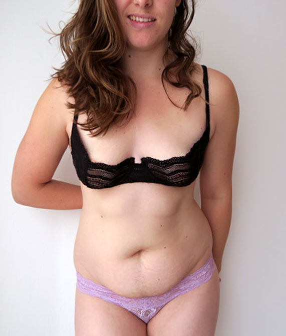 The author Liz wearing a geometric black lace demi bra and pale purple lace thong by designer Cosabella.