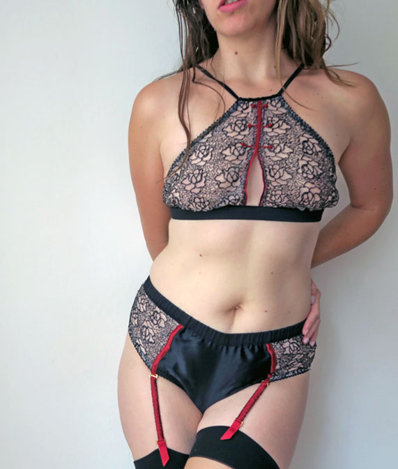 The author Liz wearing a floral open lace bralette with red silk piping by Chinese designer Pillowbook