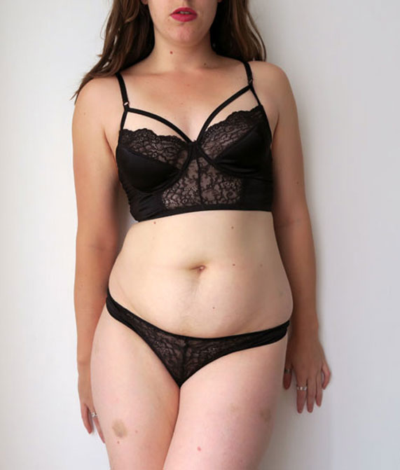 The author Liz wearing a black lace and silk balconette bra and thong by designer Else Lingerie.