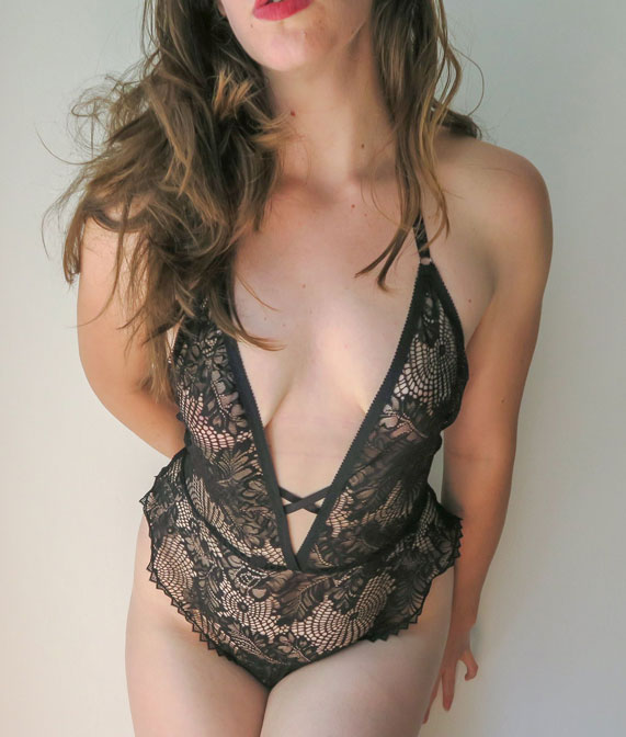 The author Liz wearing a spiderweb lace bodysuit by designer Hopeless Lingerie.