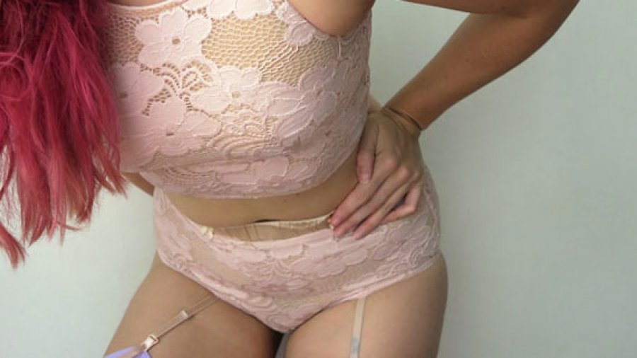 The author Liz wearing a pink floral open lace longline bralette by designer Mmadelyne